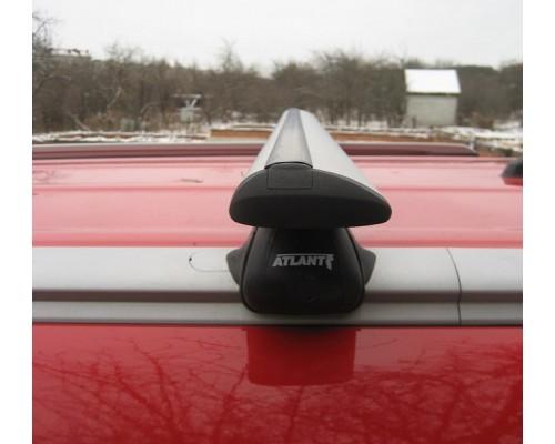 Багажник Atlant с крыловидными дугами на интегрированные рейлинги